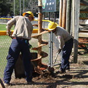 Lineman installing a pole